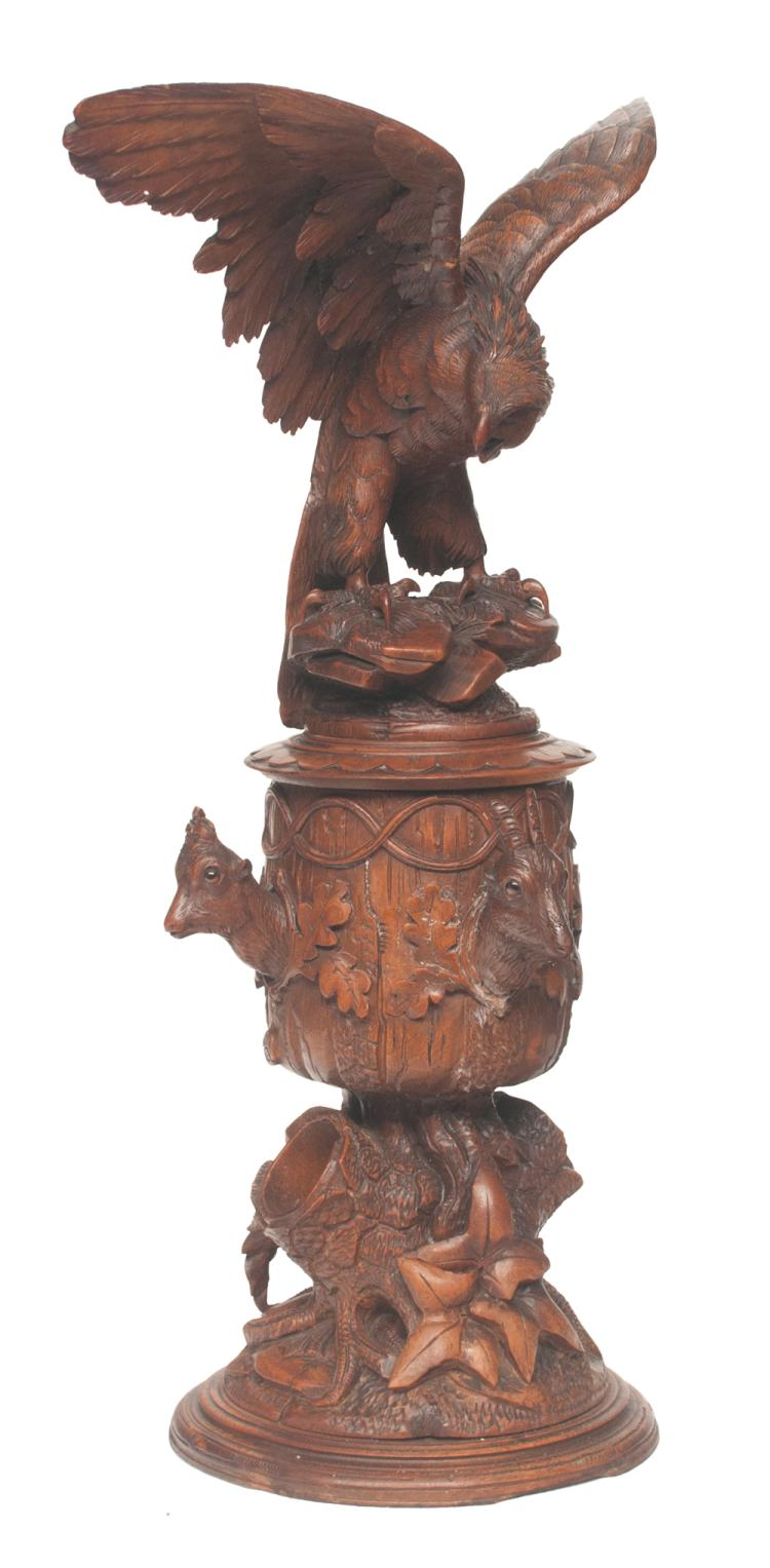 Carved walnut urn shaped wooden humidor with four deer heads on the sides and carved eagle with outstretched wings at the top, 24