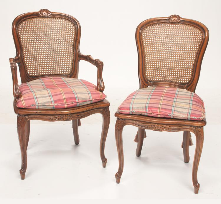 Set of ten Louis XV style fruitwood dining chairs with shell carved cane panel backs, carved aprons, and on cabriole legs, armchairs; 22