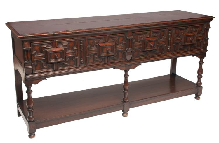 Jacobean oak dresser base with geometric trim drawer fronts on turned legs with lower shelf, c.1840, 72