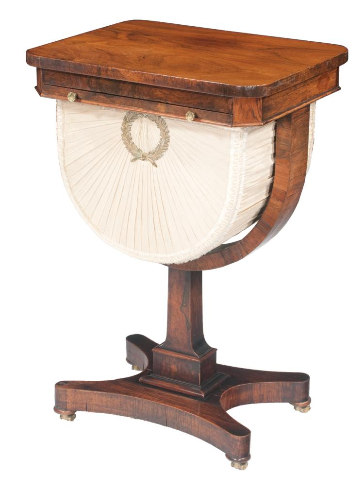 Regency style mahogany sewing table with one drawer with fabric covered well base has square tapered column on bun feet, 18.5