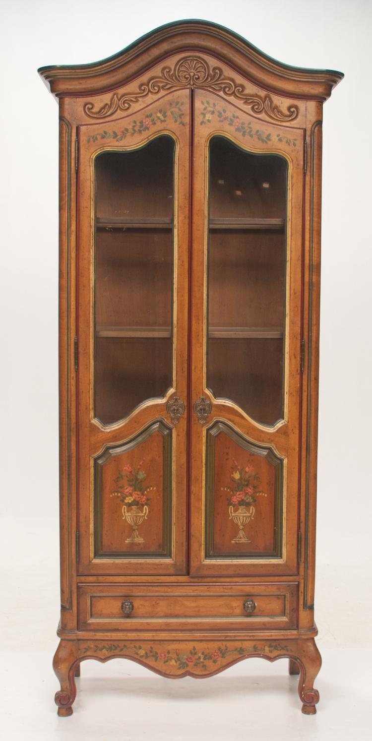 French style decorated display cabinet with arched and shell carved pediment, double doors with upper glass panels above raised wooden panels with floral decoration on cabriole legs with scroll feet, 33