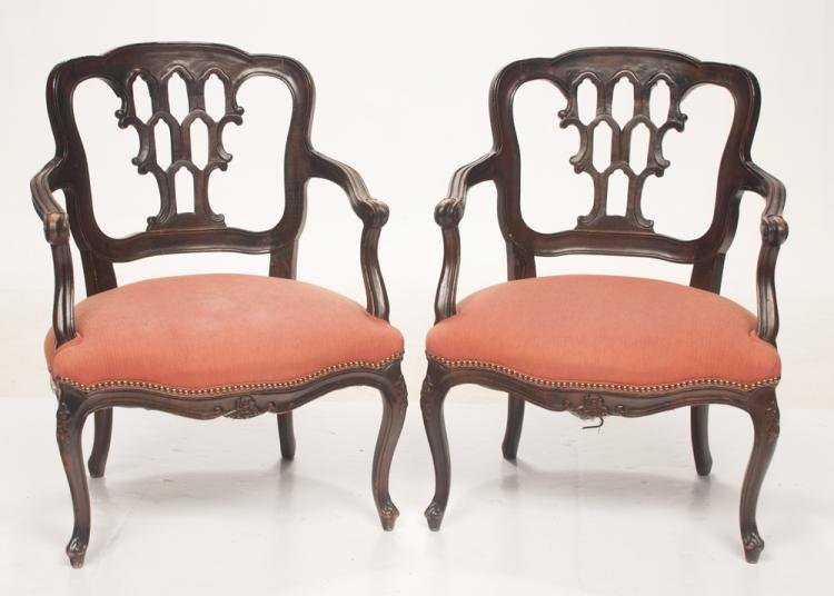 Pair of Louis XV style fruitwood armchairs with pierced splat backs, shaped arms, carved apron and carved cabriole legs, 25