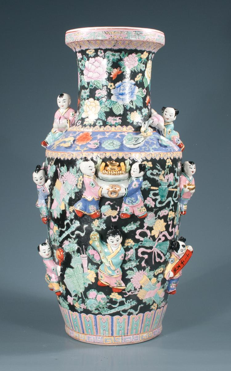 Chinese porcelain palace urn with figures of young Chinese boys in relief and with multicolor floral decoration, 27