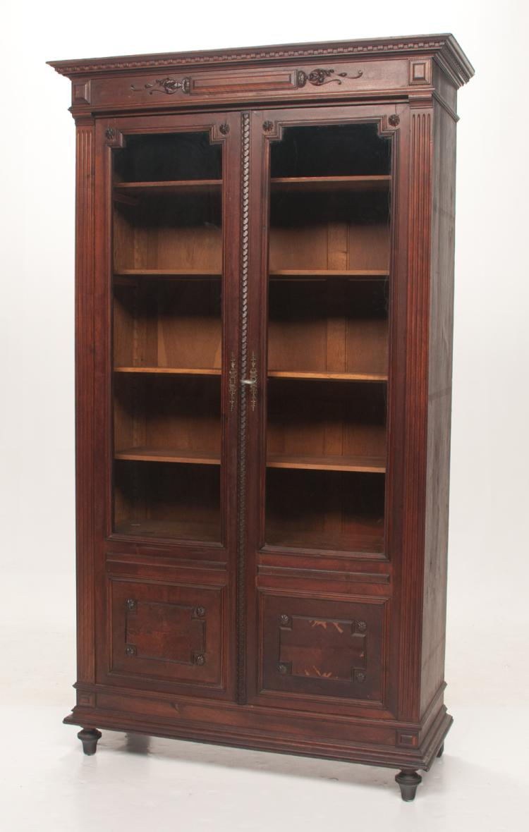 English mahogany display cabinet with dentil crown moulding, carved cornice, double glazed glass doors with moulded base and on turned feet, c.1860, 43