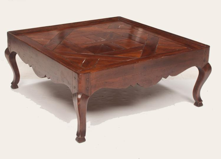 Country French style fruitwood coffee table with parquetry inlaid top and shaped apron on cabriole legs, 38