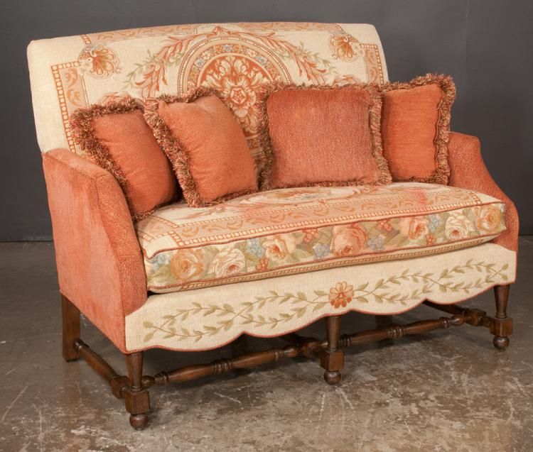 Jacobean style upholstered settee with scalloped apron, covered in a custom leaf and floral fabric on block and turned legs with stretcher by Fairfield, 54
