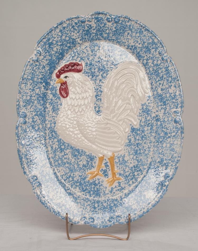 Oval china platter with scalloped border and rooster decoration in relief by Towle, 19