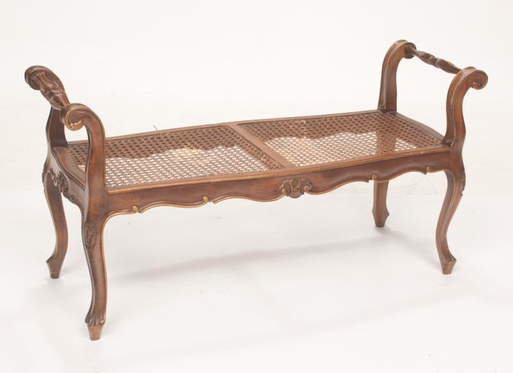 Louis XV style carved fruitwood window bench with scroll carved arms, shell carved apron and cane seat, c.1900, 43
