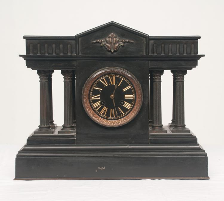 Black marble mantle clock with cathedral shape top, brass mounts and four fluted columns, c.1900, 17