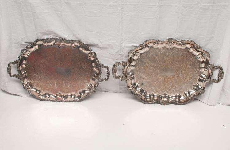 Two oval English silver plated footed serving trays with engraved decorations, 29