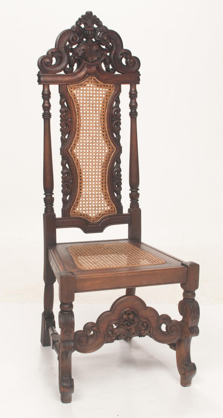 Jacobean oak side chair with pierced scroll and plume carved pediment on the back, pierced carvings on the sides, cane seat and back on carved cabriole legs with carved stretcher, 20