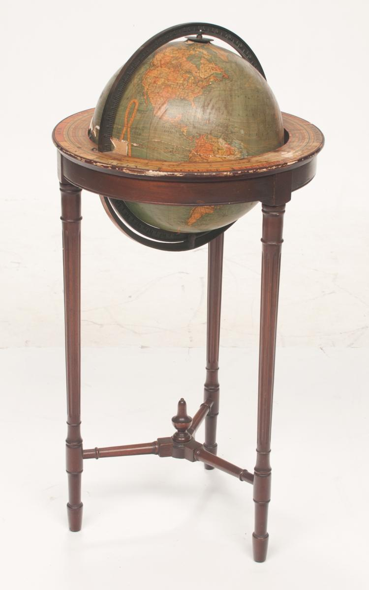 Terrestrial globe in a wooden stand on three fluted tapered legs with stretcher by Kittinger Furniture Co., globe As Found, (slight damage on one side), stand is 16