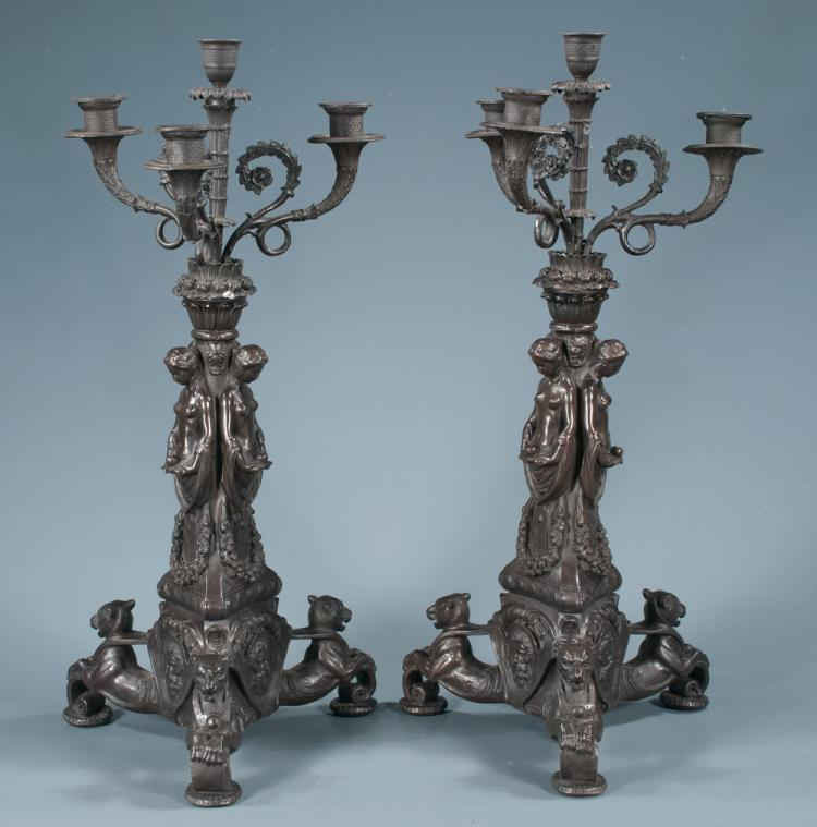 Pair of French spelter, four branch candelabra with three figures of women in column and on triangular dog form bases, 21.5