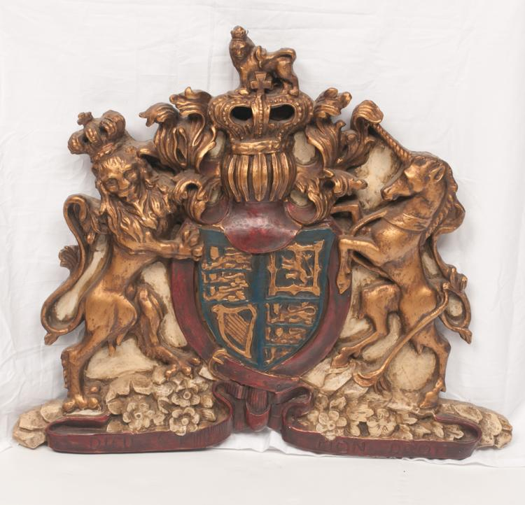 Gold gilt and decorated English coat of arms with a lion and a unicorn on the sides and having crown pediment, 25