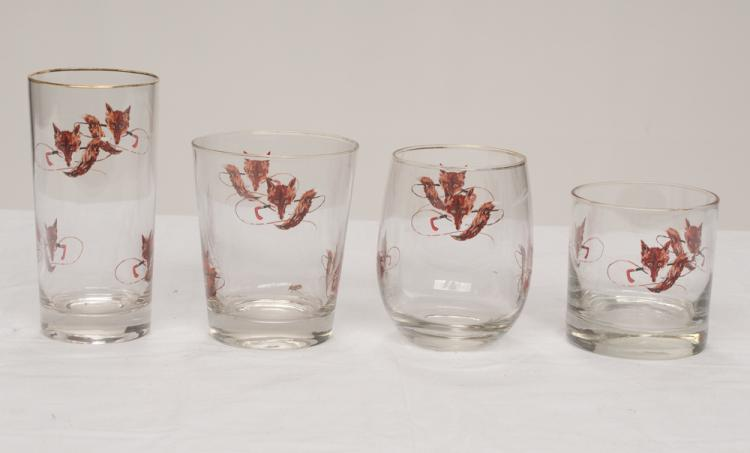 Group of 21 glasses and tumblers with enamel fox head decoration