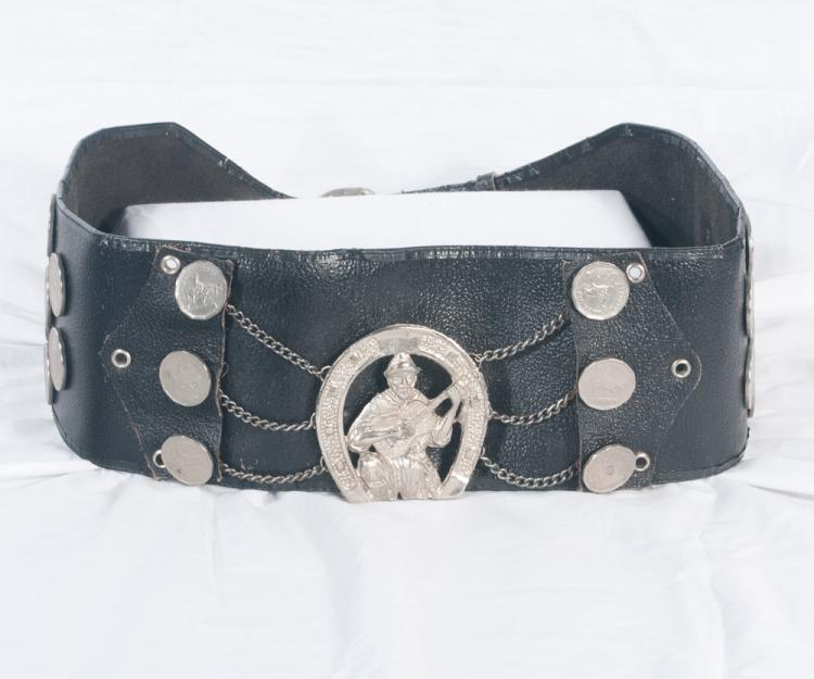 Wide leather belt mounted with 26 Argentina silver coins and with an image of Tom T. set in a horseshoe