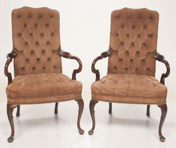 Pair of Queen Anne style mahogany armchairs covered in a brown suede with tufted back and seat, brass nail trim, shaped arms on cabriole legs with pad feet, 26