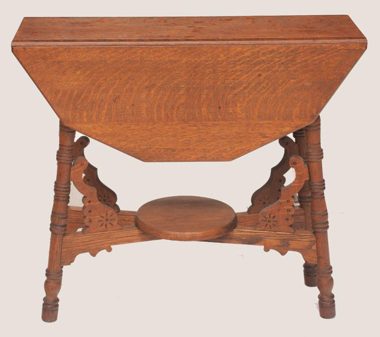 Oak gate leg table on turned legs with cross stretcher with carved supports and lower platform, 31