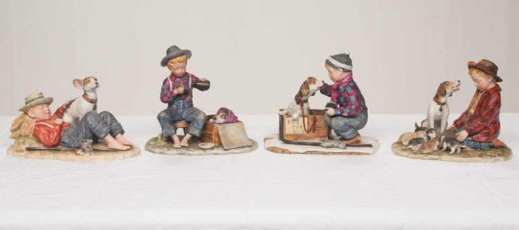 Group of four Norman Rockwell figures of young boys with dogs