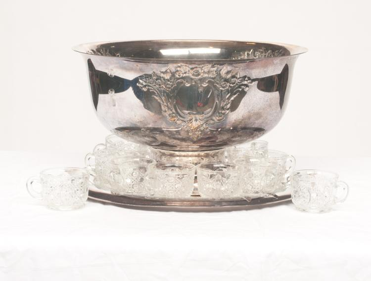 Silver plated punch bowl with leaf and floral design in relief, 15