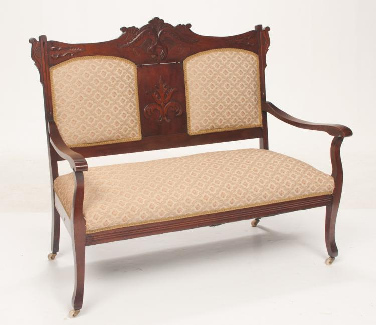 American Victorian mahogany settee with arched leaf carved back, scroll shaped arms on tapered splay legs, 46
