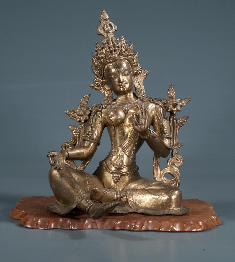 Gilt brass sculpture of an Indian Princess seated on a wooden stand, 11