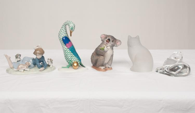 Bacarrat crystal cat laying down, crystal seated cat, Boehm Koala bear, Herend swan and a Lladro figure of a young girl with three puppies, five pieces
