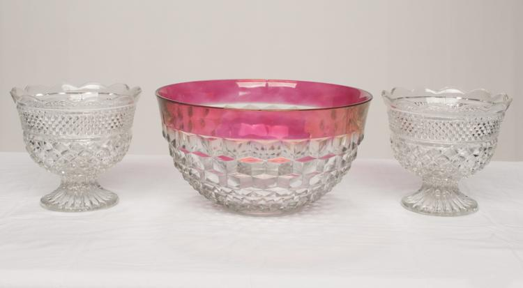 Pair of pattern glass compotes in a diamond cut design with scallop tops, 8