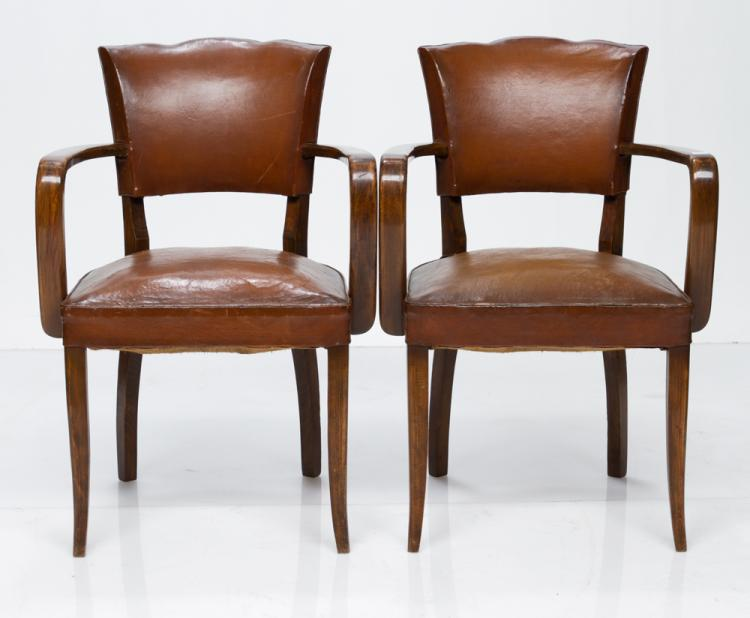 Pair of French club chairs with brown leather seats and backs and on square tapered splay legs