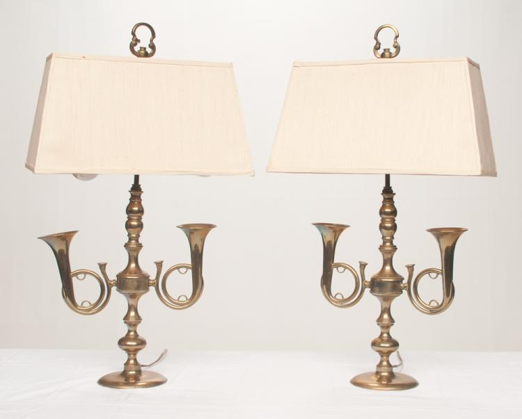 Pair of brass lamps with double hunting horns on a circular bases with shades, 28