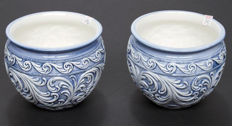 Pair of blue and white Italian porcelain cache pots with scroll decoration, 9