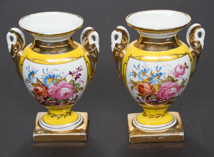 Pair of yellow French porcelain vases with multicolor floral decoration, 11