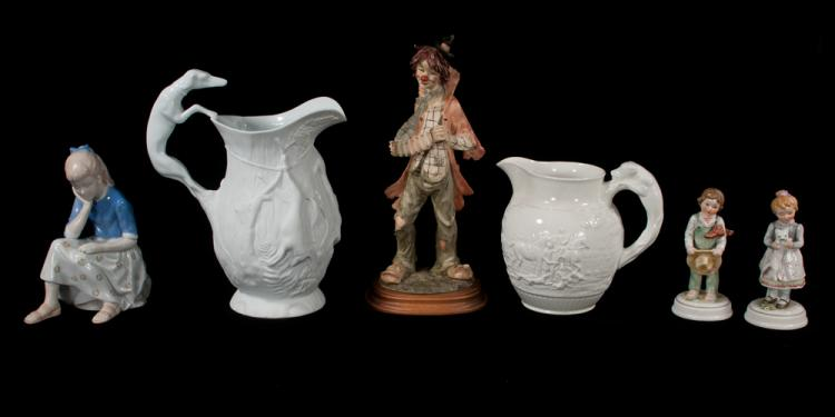 Two white china pitchers, porcelain figure of a young girl, a pair of figures of young boy and girl and a moulded figure of a clown, six pieces