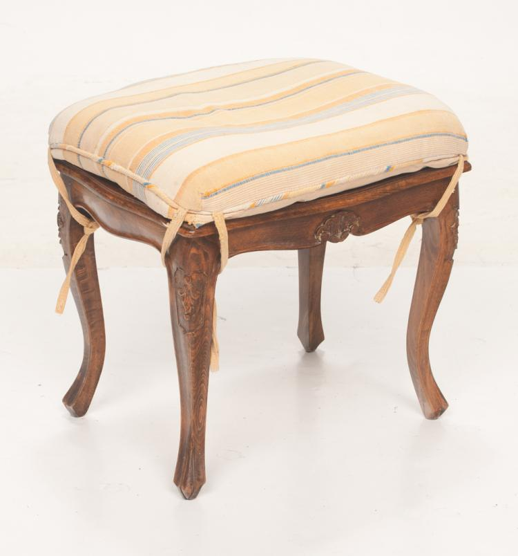 Country French style fruitwood stool with shell carved apron and carved cabriole legs, 19