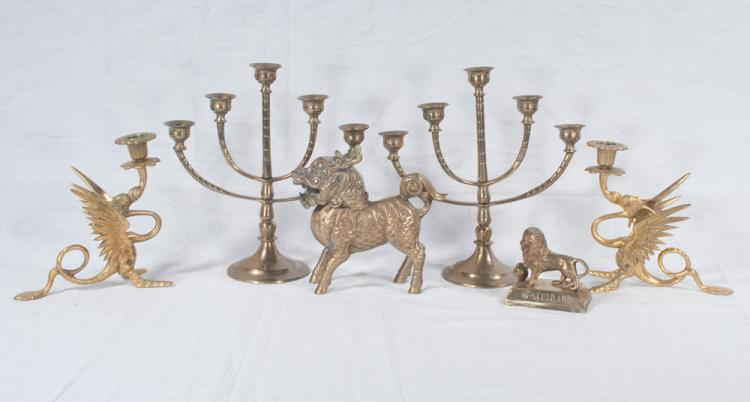Pair of brass five branch candelabra, pair of brass dragon candleholders, a brass fu lion and a small brass lion marked Waterloo, six pieces