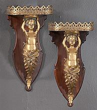 Pair of French bronze and mahogany wall brackets, the gallery edged brackets supported on bronze putti, c.1890, 7