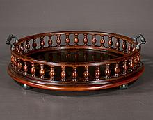 English double handled circular wooden gallery edged serving tray with painted floral decorations on bun feet, 21
