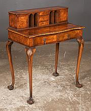 Chippendale style walnut serpentine front writing table, top fitted with cupboards on each end, pigeon holes and three drawers in the center, c.1900, 29