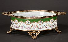 Louis XV oval bronze mounted green and white porcelain center piece with floral decoration, c.1890, 16