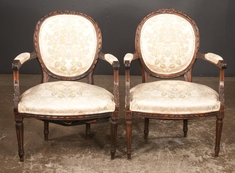 Pair of louis xvi style walnut fauteuils with ribbon carved for Furniture northgate
