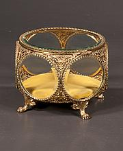 Circular Matson style jewelry casket, the bevelled glass hinged top above six circular bevelled glass panels on claw feet, 6.50