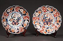 Two companion Imari porcelain chargers with blue, gold and bittersweet floral decoration, c.1860, one is 9.75
