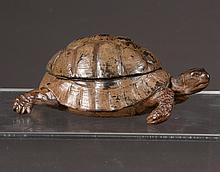 Cold painted bronze depicting a turtle with hinged back, revealing a porcelain inkwell, 2.50