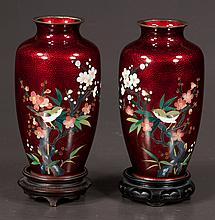 Pair of Japanese red foil cloisonné vases having bird and floral decoration on carved teak stands, 7