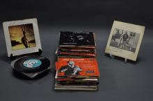 A COLLECTION OF APPROXIMATELY 60 45'S. Including Louis Armstrong, Bruce Springsteen & Robert Palmer