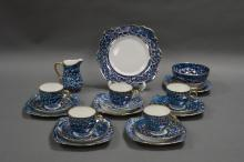 A BLUE MARBLED CZECHOSLOVAKIA TEA SET. Circa twenty pieces in five full settings, plus one extra set