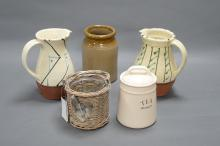 COLLECTION OF CERAMIC JUGS AND STORAGE JARS. Plus wicker candle holder.