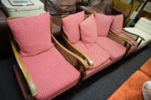 A 1930'S SINGLE LAYER BERGERE SUITE COMPRISING A TWO SEATER SOFA AND A PAIR OF ARMCHAIRS, finished i