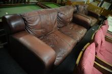 3 SEATER AND 2 SEATER BROWN LEATHER SOFAS. In an Art-Deco style on wooden block feet.