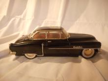 1950 Friction Cadillac Toy Car, missing ornament hood, small ding on the roof, friction motor works